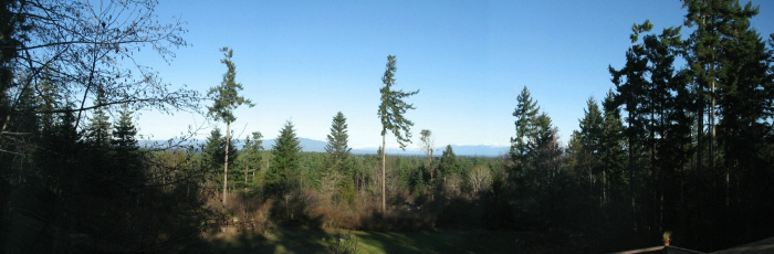 Panoramic view of sunshine coast across the strait